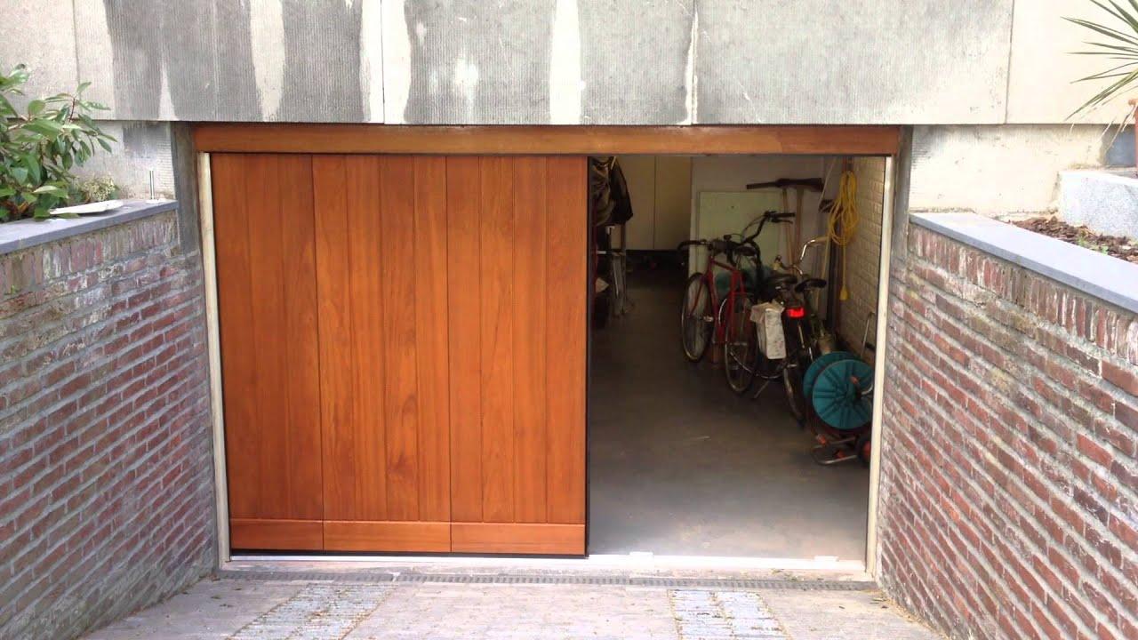 Elektrisch houten zijwaartse garagedeur doovi - Deur kast garagedeur ...