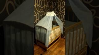 Кроватка с автоматическим механизмом укачивания