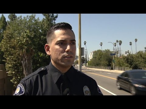 Rookie cop saves life of 12-year-old who intended to jump off bridge