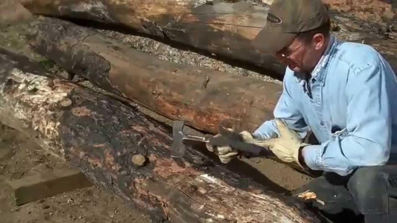 Hand Peeling Logs To Make Log Furniture By Mitchell