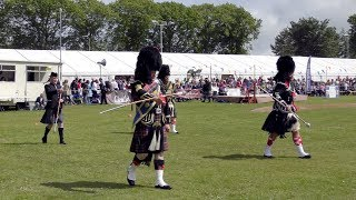 Drum Major's Mace Floursh Display during Oldmeldrum Highland Games in Aberdeenshire, Scotland 2019