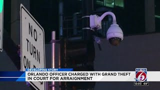 Orlando officer charged with grand theft in court for arraignment