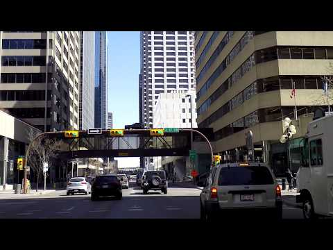 Life in Downtown CALGARY Alberta Canada - Driving Tour in Cowtown - 2018