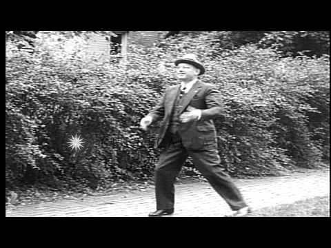 "Governor of Kansas Alfred ""Alf"" Mossman Landon walks in the garden. HD Stock Footage"