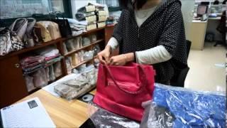 Proceso de empaque de carteras chinas - CompraBolsos.com