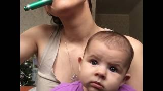 Mom Does Makeup While Holding Baby