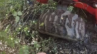 TRACTOR  STUCK IN SWAMP