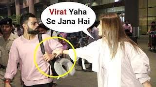 Anushka Sharma Cutely Stops Virat Kohli From Going In Wrong Direction At Airport