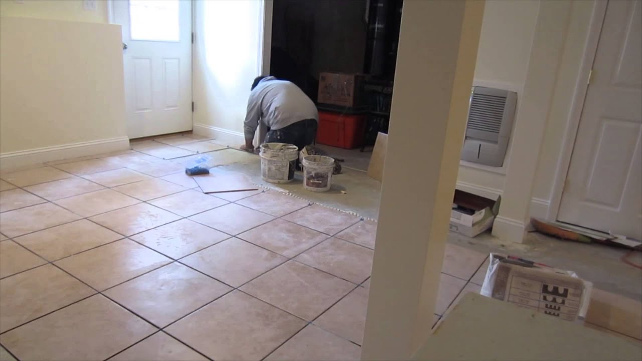time lapse of a 16 x16 ceramic tile installation on a basement concrete floor