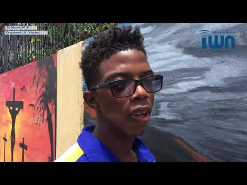 Young artists paint mural in Kingstown