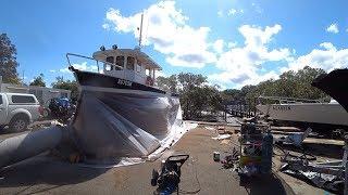 sandblasting-and-priming-the-steel-trawler-hull