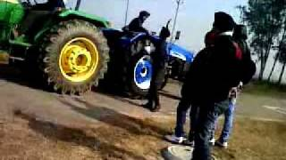 johndeere 5060e vs. new holland 6500.avi