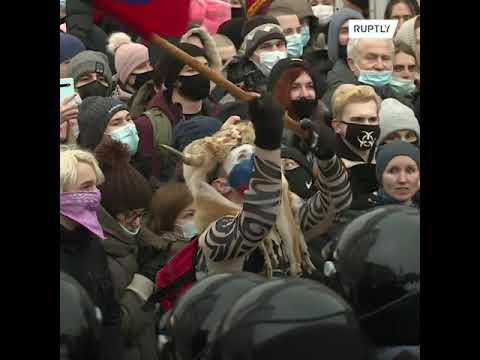 Face-painted man in horned fur cap arrested at unauthorised protest in central Moscow
