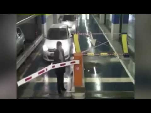 gangsta woman destroys parking gate barrier