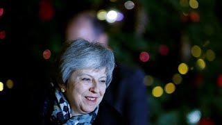 May heads for Brussels after surviving rebels