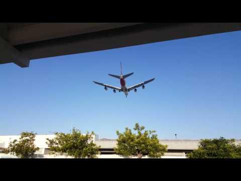 747 landing at LAX from Hertz Rental Car return parking lot