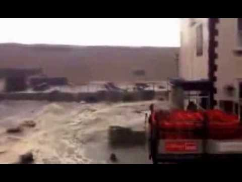HUGE waves breaking flood defences at Chesil beach, Chiswell