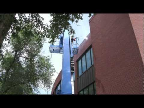 Construction Cleanup Using A 65 Foot Boom Lift.mov
