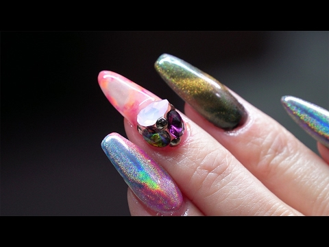Sculpted almond gel nail with marbling design and Swarovski crystals- Akzentz booth at ISSE