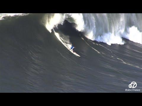 Surfers catch big waves at Mavericks in Half Moon Bay