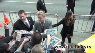 Celebrities sign autographs at The Avengers premiere in Hollywood