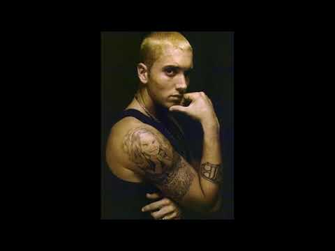 Eminem Tattoos and what they mean to him
