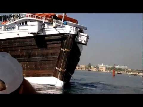 Dhow ship being towed at Dubai Creek