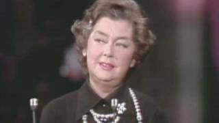 Rosalind Russell receiving a special Oscar® statuette