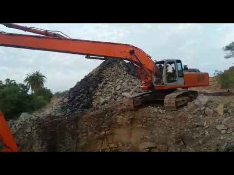 EX 350 super long reach excavating blasted rocks.
