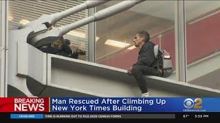 Man Climbs New York Times Building