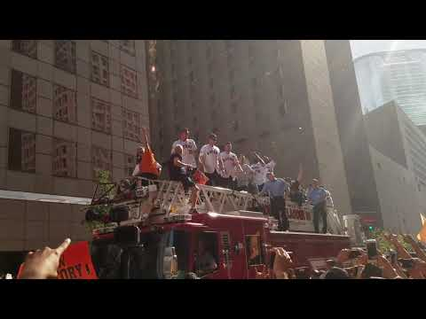 Musgrove catches and chugs beer thrown from multi story garage during the World Series Parade