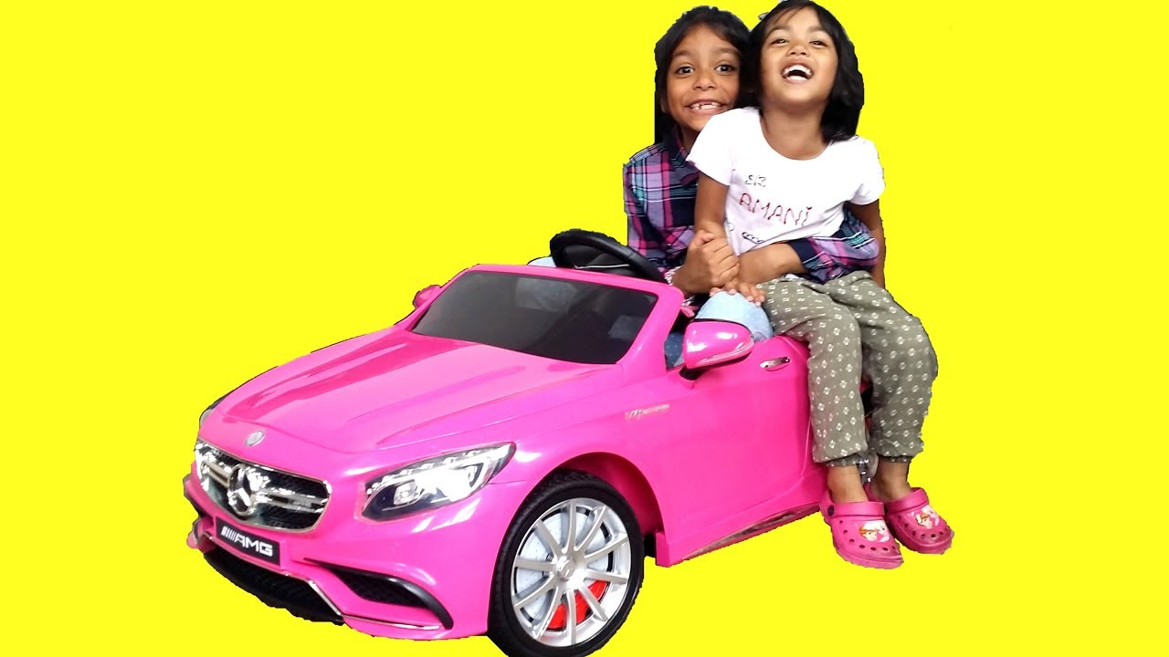 Little girls unboxing pink mercedes s63 amg ride on car for Pink mercedes benz power wheels