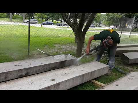 Stone cleaning with water and crushed glass mix