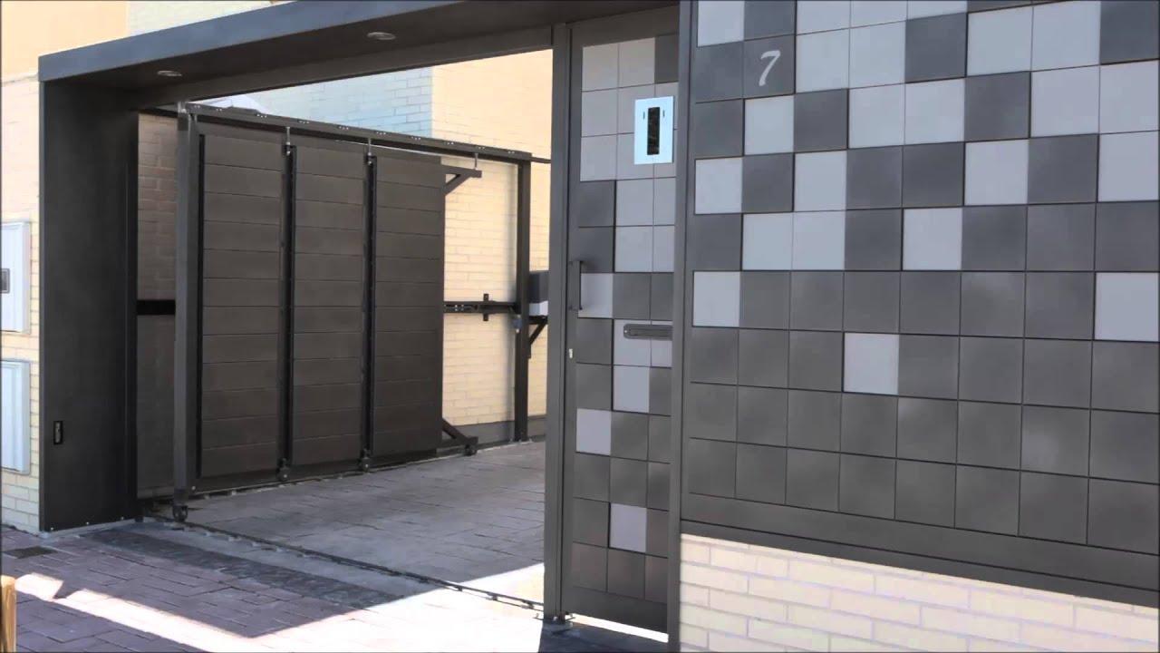 Puerta bonita de garaje corredera seccional youtube for Puertas corredizas de metal