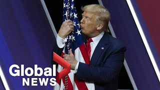 President Trump hugs, gives kiss to American flag at CPAC Conference