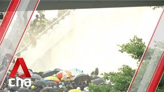 Hong Kong police fire water cannons and tear gas at protesters outside Legislative Council