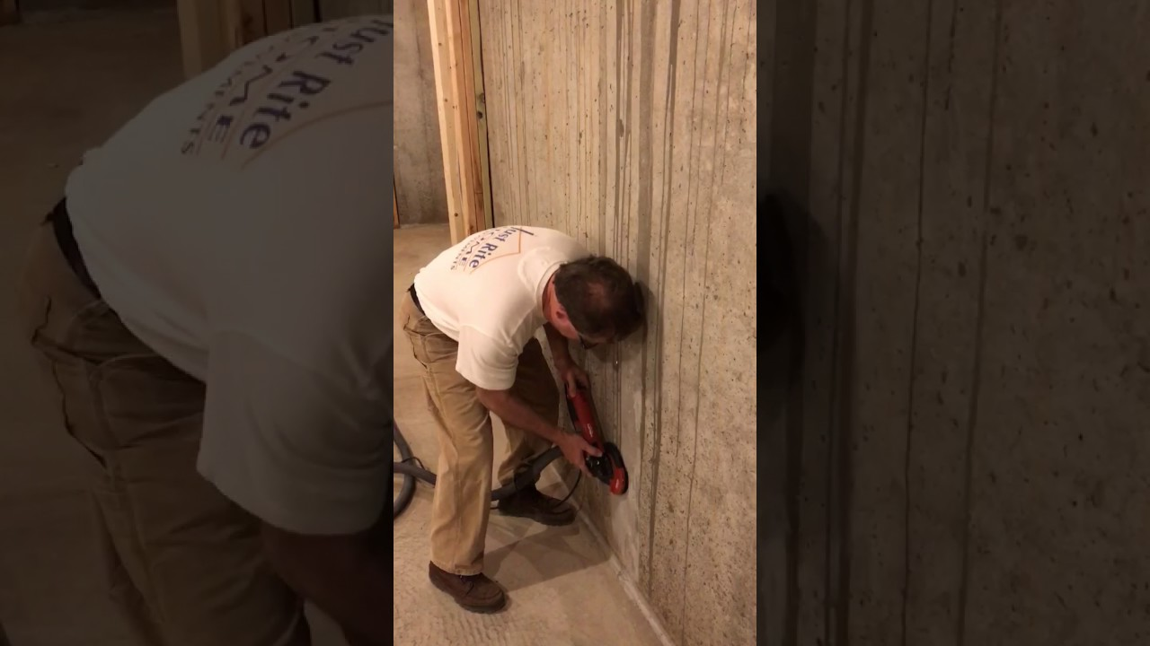 Removing concrete splatter from a basement wall with Lackmond's F5 Flexible  grinding wheel