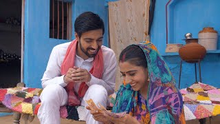 Young good looking village husband giving Indian rupee notes to his wife - future investment