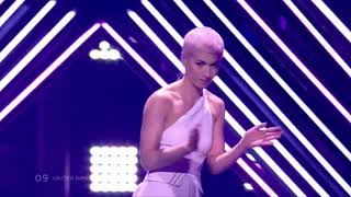 Eurovision: SuRie carries on after stage invasion