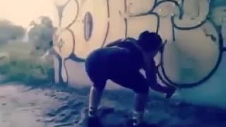 Girl Doing Throw Up Graffiti