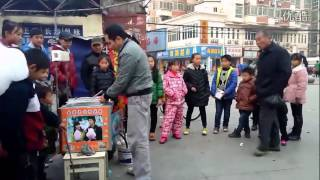 A Chinese cotton candy seller and dancer