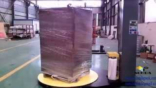 Automatic pallet stretch wrapping machine with forklift channel