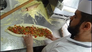 Freshly made Wood Oven cooked Turkish Pizza (Pide) by Master Baker Gökhan at Babayani Cafe, London..