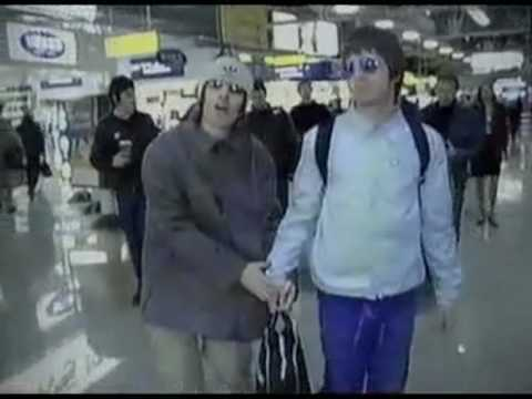 Oasis: Liam & Noel Gallagher holding hands 2000