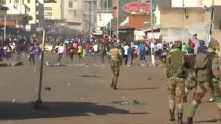 zimbabwe breaking news soldiers attacking unarmed journalist shooting at civilians