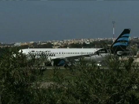 Raw: Passengers Leaving Hijacked Libyan Plane