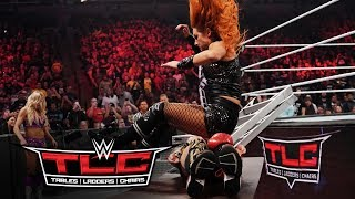 Becky Lynch sends Asuka through a table with a flying leap: WWE TLC 2019