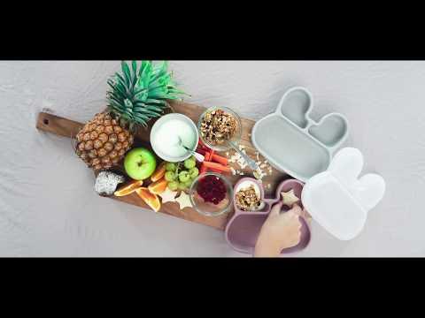 Preparing a healthy snack for kids in We Might Be Tiny's silicone suction plate