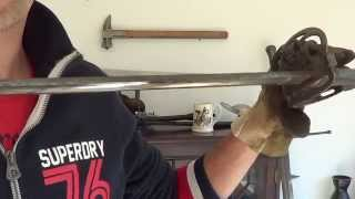 Cleaning antique or modern swords and knives with a buffing wheel