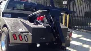 Custom built Repo tow truck. Dynamic slide in unit.